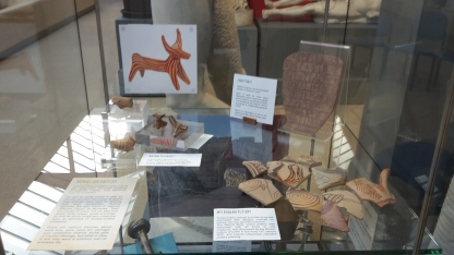 Pottery, figurines, and Linear B tablet cast